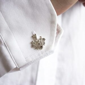 Silver cufflinks with coat of arms on cuff