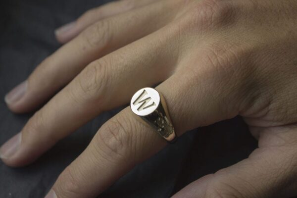 Yellow Gold 9K Round Signet ring with engraved band on hand
