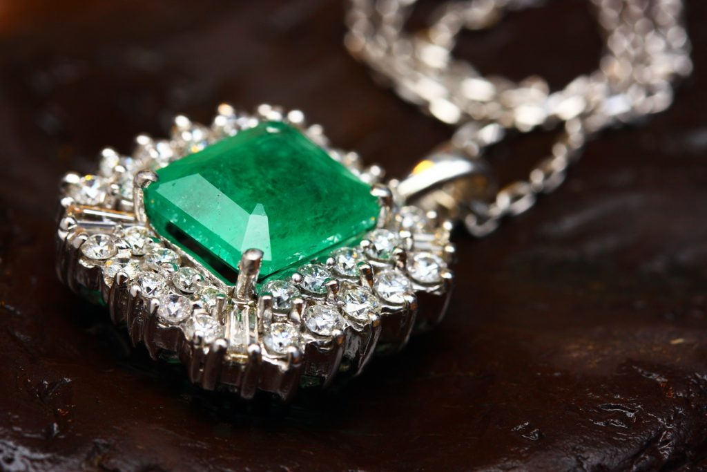 A close-up picture of an emerald gemstone pendant.