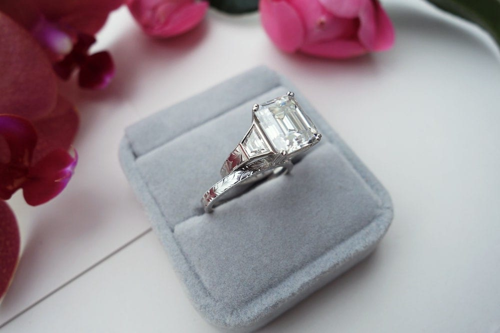 Platinum Ruthenium .950 Engagement ring with Emerald cut Moissanite 3 carat and trapezoid sidestones