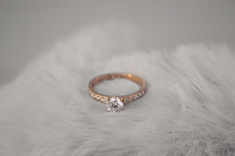 Lab grown diamond solitaire with lab grown diamond channel